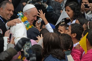Pope in Brazil: Pope Francis is surrounded by children during his visit to the Varginha fav