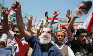 Members of the Muslim Brotherhood and supporters of Mohamed Morsi during a rally around Rabaa Adawiya square, Cairo
