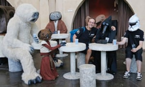 Actors in costumes with visitors at the Star Wars Celebration festival in Essen, Germany.