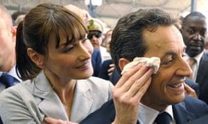 Carla Bruni-Sarkozy mops Nicolas's brow
