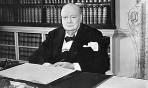 Winston Churchill sitting at his desk