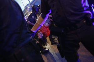 20 Photos: Police officers detain a demonstrator during a protest in Madrid