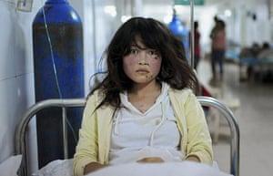 20 Photos: An injured woman at a hospital after a 6.6 magnitude earthquake hit Dingxi
