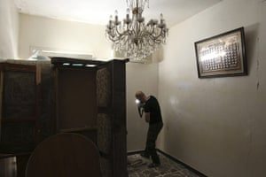 20 Photos: A Free Syrian Army fighter takes up a position inside a house in Aleppo