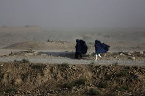 20 Photos: Women walk on a windy day outside Kabul, Afghanistan