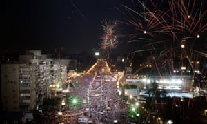 Fireworks burst over opponents of Egypt's ousted President Mohammed Morsi during a protest at the presidential palace in Cairo on July 26.