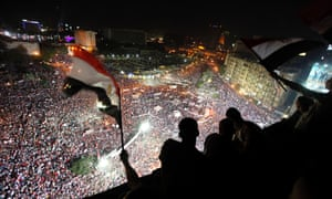 Anti-Morsi protesters chant slogans during a mass protest to support the army in Tahrir square in Cairo.