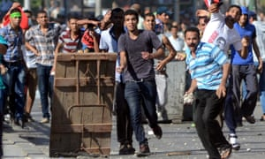 Egyptian opponents and supporters of ousted President Mohammed Morsi clash during a protest in the coastal city of Alexandria.