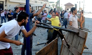 Opponents of ousted president Mohamed Morsi clash with supporters of the Muslim Brotherhood in Alexandria today.