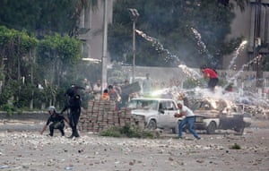 Cairo clashes: Fireworks are set off near police