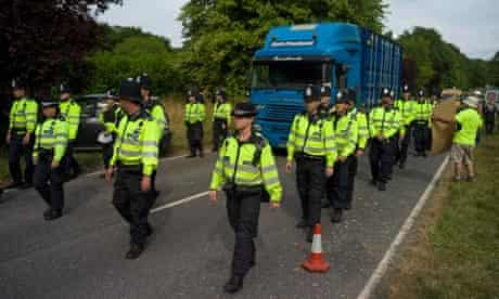 Police escort a lorry containing drilling equipment