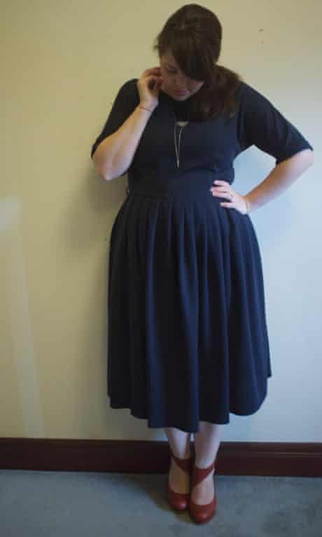 Blogger wearing midi-length navy blue dress