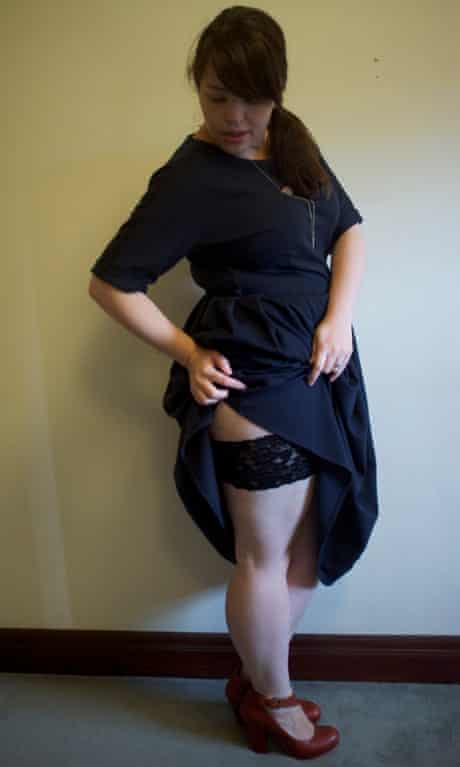 Blogger wearing a midi dress that she's pulled up at the side to show a a band of lace around her thigh