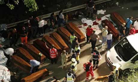 Coffins are lined up near the crash site outside Avellino.