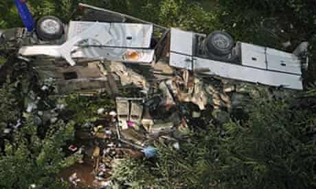 The wrecked bus lies where it fell after plunging off the road near Avellino.