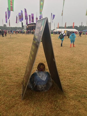 GuardianWitness WOMAD: Sheltering from the rain at WOMAD 2013