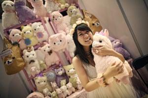 Hyper Japan London: A stall holder hugs a llama soft toy