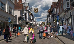 Shoppers in Guildford's historic cobbled high street