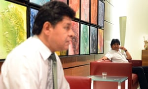 Bolivian defence minister Ruben Saavedra Soto (L) and Bolivian President Evo Morales sit in a waiting lounge in Vienna airport