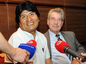 Bolivia's President Evo Morales, left, talks to reporters as he sits next to Austrian President Heinz Fischer at Vienna's Schwechat airport