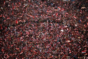 An aerial view shows protesters against Egyptian President Mohamed Mursi waving national flags in Tahrir Square in Cairo July 3, 2013.
