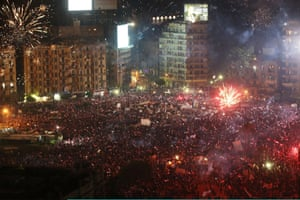 Fireworks and shouts of joy emanate from Tahrir Square after a broadcast by the head of the Egyptian military confirming that they will temporarily be taking over from the country's first democratically elected president Mohammed Morsi on July 3, 2013 in Cairo, Egypt.