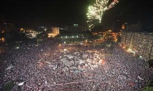 Fireworks light up the sky as hundreds of thousands of Egyptians celebrate after Egyptian defence minister  Adel Fattah al-Sisi's speech announcing The Egyptian army toppling Islamist President Mohamed Morsi in Egypt's landmark Tahrir square on July 3, 2013 in Cairo