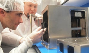 Made in Space co-founder Jason Dunn (left) and colleague Mike Snyder examine their printer