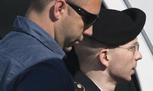 Bradley Manning arrives alongside a military official at a US military court facility for the verdict in his trial at Fort Meade, Maryland