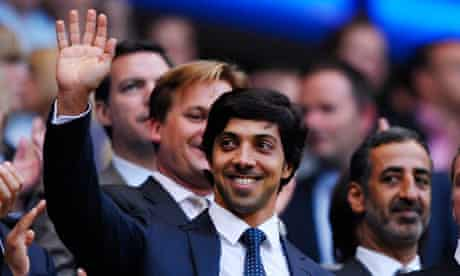 Sheikh Mansour waves to Manchester City fans