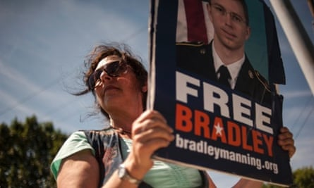 A supporter of Bradley Manning protests outside the main gate before the reading of the verdict in Manning's military trial at Fort Meade.