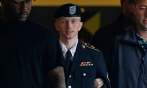 radley Manning is escorted to a security vehicle outside of a courthouse in Fort Meade
