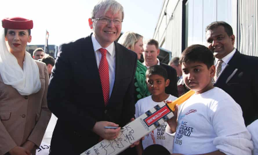 Kevin Rudd signs a cricket bat during the official launch of the ICC Cricket World Cup to be held in Australia and New Zealand in 2015.