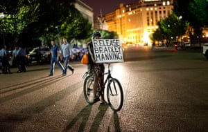 Bradley Manning protests: A supporter carries a sign while during a night time demonstration in front
