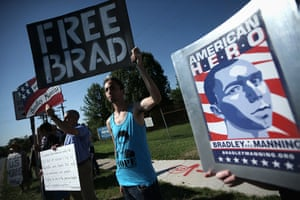 Bradley Manning protests: Supporters hold signs to show support during a demonstration outside the ma