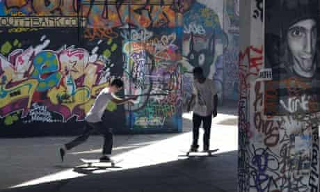 Skateboarders practice on the South Bank in London