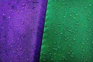 Close up Wimbledon: Rain drops glisten on a Wimbledon branded umbrella