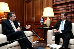 epa03774433 Greek Prime Minister Antonis Samaras (L) speaks with German Foreign Minister Guido Westerwelle (R) at his office in Athens, Greece, 04 July 2013. Westerwelle is in Athens on a one-day working visit,