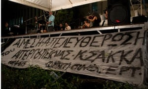 A banner before the stage reads, immediate release of Kostas Sakkas, who is on hunger strike