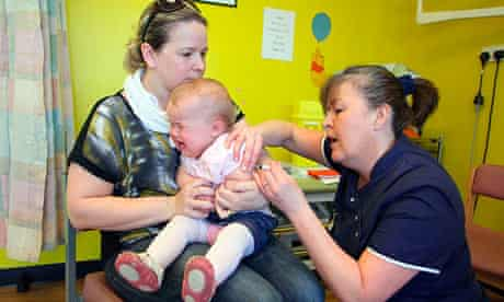 The MMR vaccine is given to a 14-month-old during the recent catch-up campaign in Wales