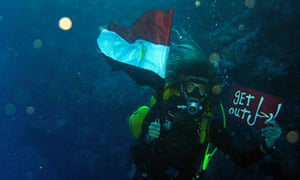 An Egyptian diver participates in an underwater protest off Sharm el-Sheikh