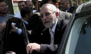 Mohammed Badie, the head of Egypt's Muslim Brotherhood, leaves a polling station in Cairo in March 2011.