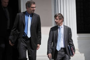 European Commission Director Matthias Morse (R) and European Central Bank (ECB) mission chief for Greece Klaus Masuch leave the prime minister's office in Athens after their meeting on July 4, 2013.