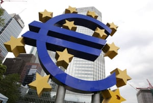 The Euro logo is seen in front of the European Central Bank (ECB) building prior to the meeting of the Governing Council in Frankfurt am Main, central Germany, on July 4, 2013.