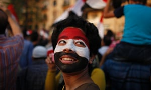 A boy with his face painted in the colours of Egypt's national flag attends a rally held by anti-Mursi protesters at Tahrir square in Cairo.