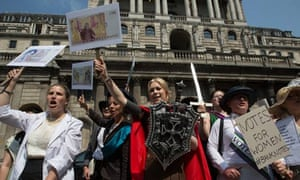 Activists dressed as historical figures protest outside the Bank of England