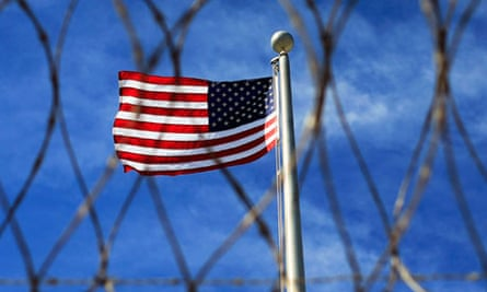 US flag flying over Camp VI, a prison used to house detainees at the naval base at Guantanamo Bay
