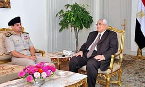 Egypt's interim president Adly Mansour meets with his defence minister General Abdel-Fatah al-Sisi