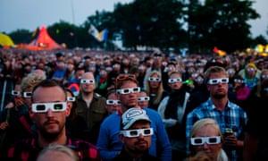 Fans watch Kraftwerk perform on Orange Scene stage at the Roskilde Festival in Denmark last night.