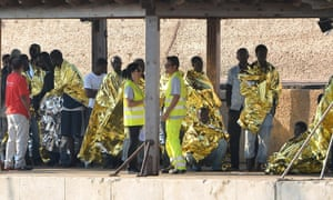 Immigrants disembark as they arrive in the island port in Lampedusa, Italy. Pope Francis is visiting the island today to meet immigrants and lay a wreath in memory of the many thousands who lost their lives attempting the dangerous crossing trying to reach Europe.